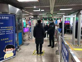 Man entering security in Beijing Metro.