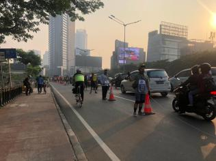 By creating a human barrier, they showed the value of the cycle lane to its riders and to car drivers.