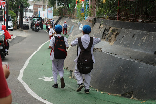 In a Jakarta neighborhood, improved pedestrian infrastructure was used by children on their daily walks to and from school.