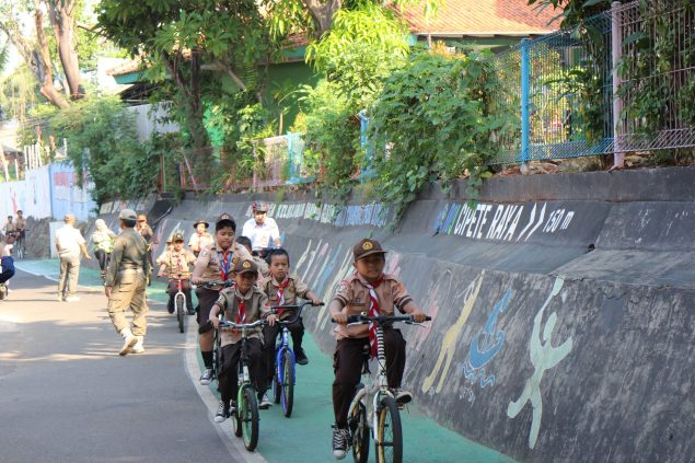 """""""If we want to cycle to the National Monument [in the center area of the city], we have to leave early in the morning to avoid the many cars on the road. We want a bike lane so that motorcycles stop blowing horns at us, scaring us and making us lose our balance."""" = Maulana, Azril, Azam, Yoga (elementary school students)"""