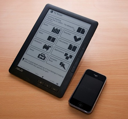 Asus DR-950 e-book reader next to iphone 1