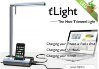 M&C tLight Desk Lamp docks iPod iPod, charges notebook and cellphone