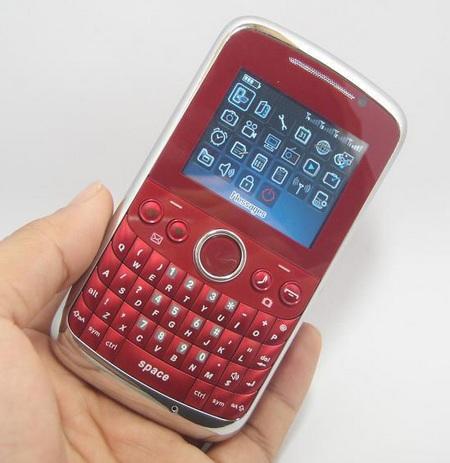 OTECH F1 Quad-SIM Mobile Phone on hand