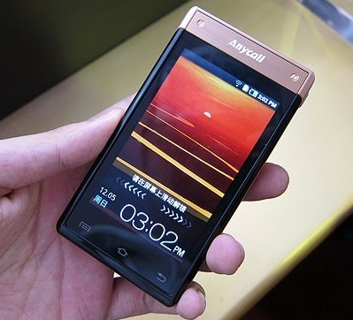 Samsung W899 Android Clamshell Phone with Two Super AMOLED Touchscreens 1