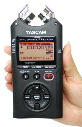 TASCAM DR-40 Handheld 4-Track Recorder on hand
