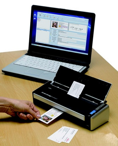 Fujitsu ScanSnap S1300i Mobile Scanner in use