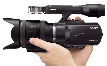 Sony Handycam NEX-VG30H Interchangeable Lens Camcorder SELP-18200 E PZ Lens hand