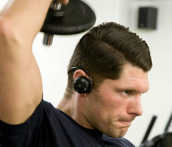 FX-SPORT VR1 Programmable Personal Trainer Wireless Headphones with built-in MP3 Player in use