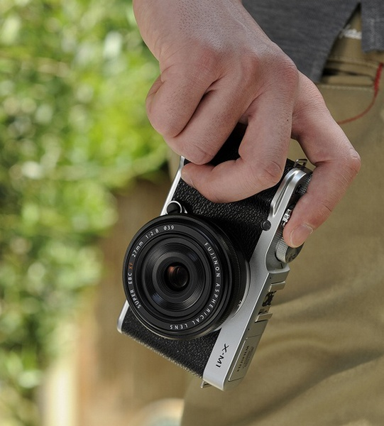 FujiFilm X-M1 Lightweight Mirrorless Camera on hand