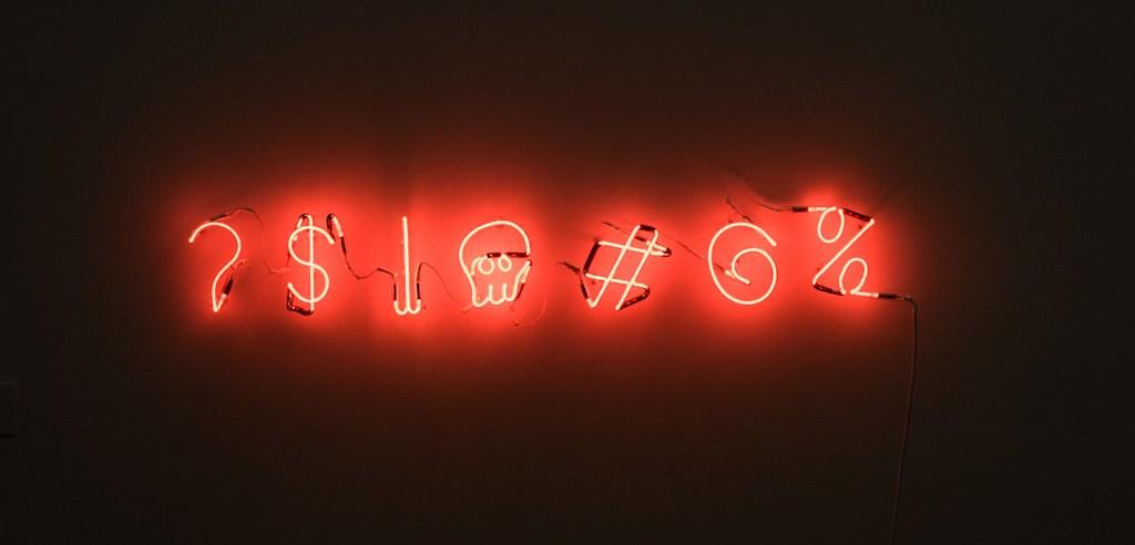 Symbols captured in red neon lights