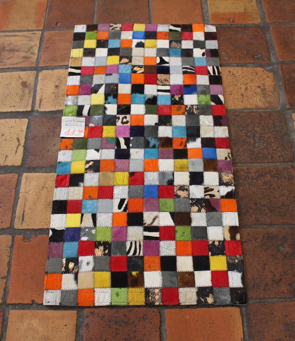 tapis patchwork en peau de vache multicolore
