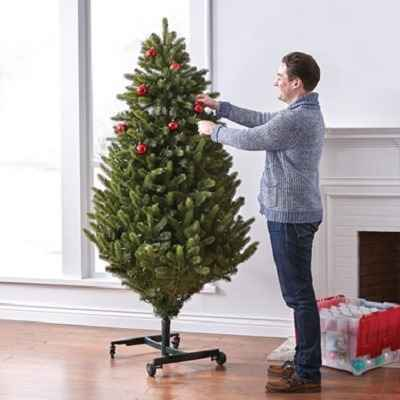 The Remote Controlled Height Adjustable Christmas Tree - Grows easily from 7 to 9 feet high with a press of a button