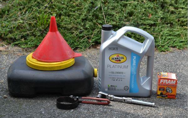 How to change oil - Oil change supplies. Oil drain pan, funnel, oil filter wrench, socket, Pennzoil full synthetic motor oil, fram oil filter