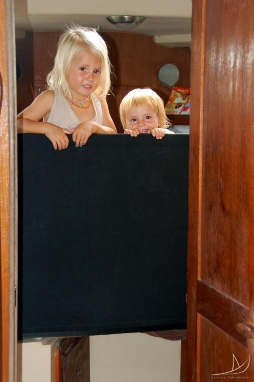 Girls stuck behind a safety wall