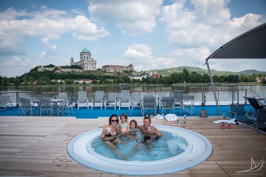 Family of four sitting in the jacuzzi on the Primadonna river boat.