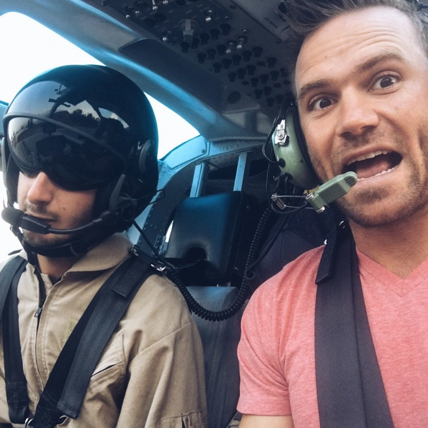 riding up front with the pilot of the helicopter