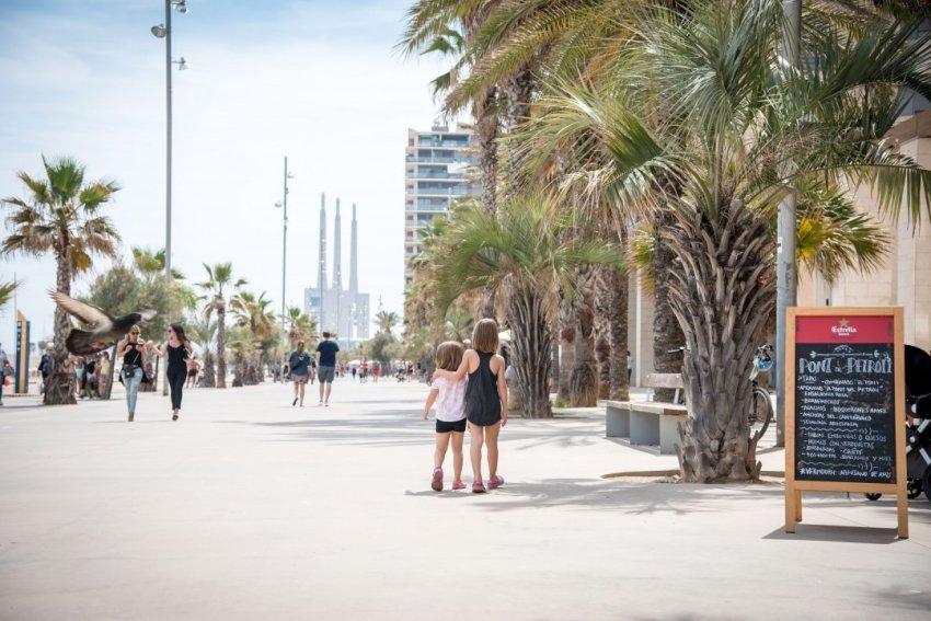 Kids walking the boardwalk in Badalona, Spain