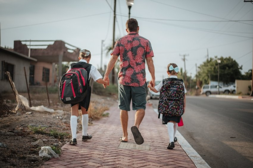 Eben walking the girls to school