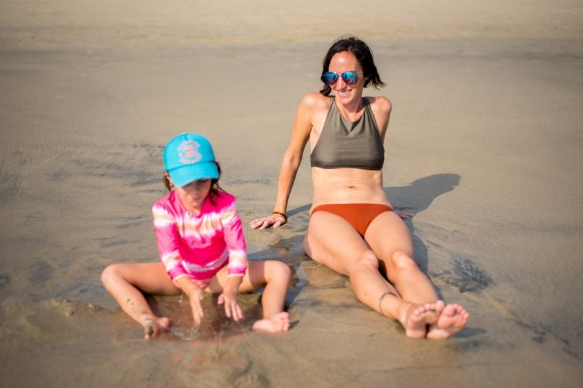 Ellia and I sitting on the beach