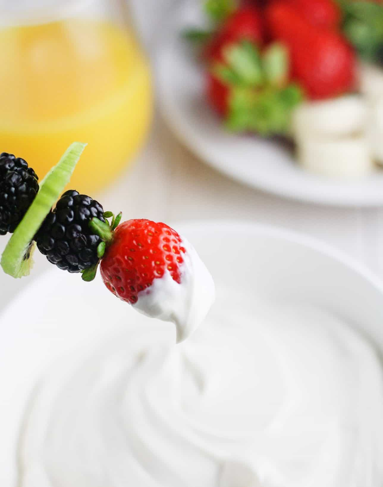 Easy, 3 ingredients cream cheese fruit dip made with Greek yogurt and fat free cream cheese. Ready in minutes! itscheatdayeveryday.com