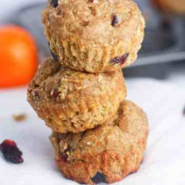 Orange Cranberry Oat Muffins- deliciously moist oatmeal muffins, made with Greek yogurt as a healthy butter substitute. These delicious muffins are a wonderfully low calorie pick-me-up recipe for breakfast! www.itscheatdayeveryday.com