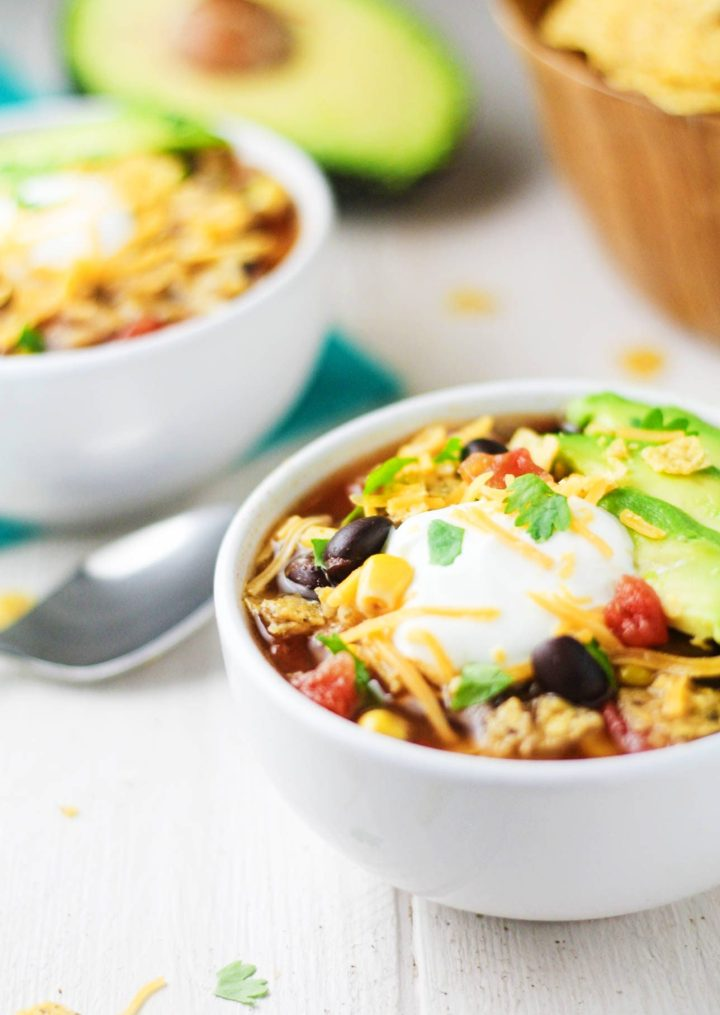 This Crock Pot Turkey Tortilla Soup is a deliciously easy twist on the traditional chicken tortilla soup recipes. Perfect cold weather comfort food! | itscheatdayeveryday.com