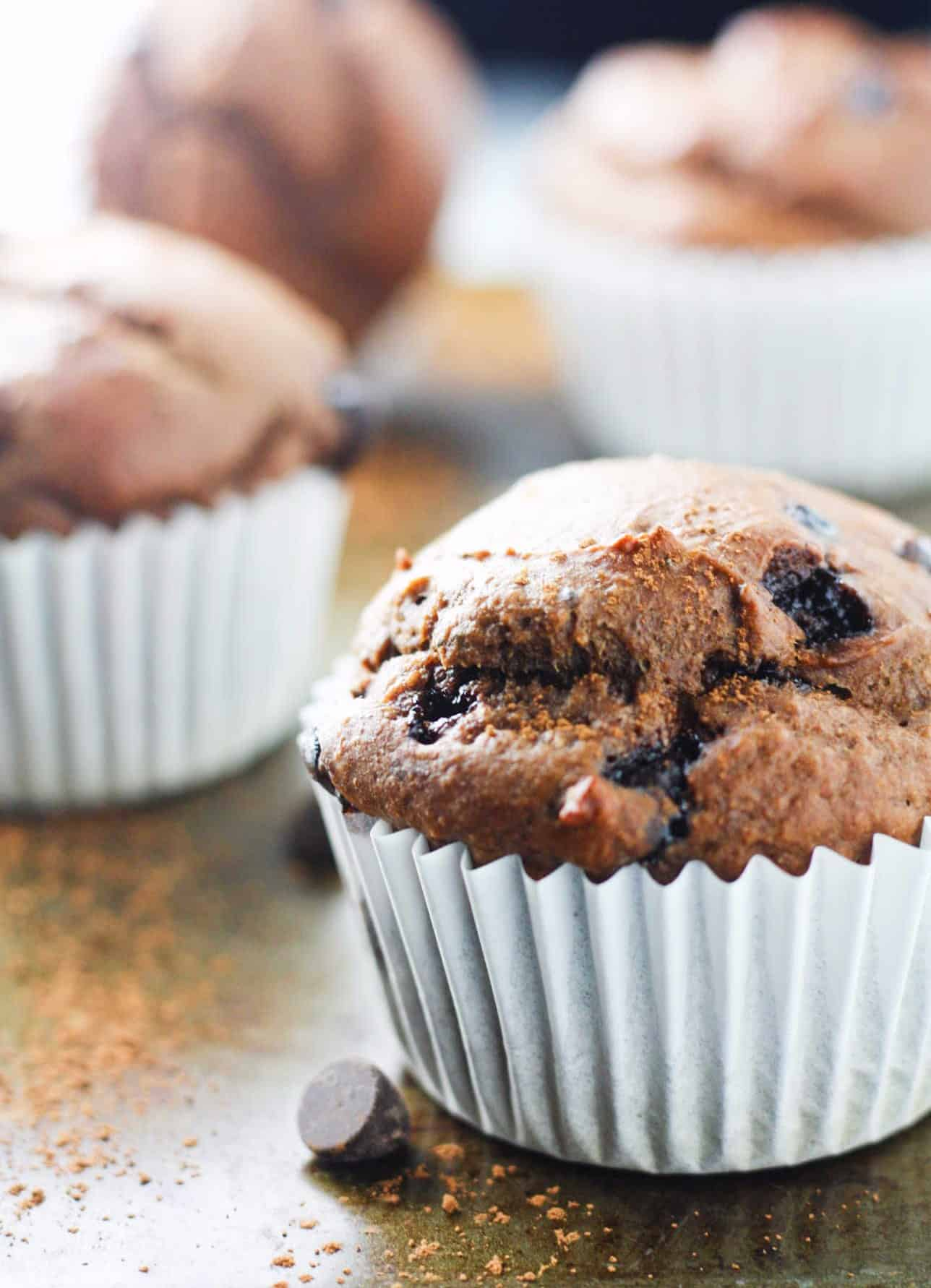 Double Chocolate Chip Protein Muffins - loaded with avocados, Greek yogurt, chia seeds and protein powder. Low in calories, high in fiber! www.itscheatdayeveryday.com