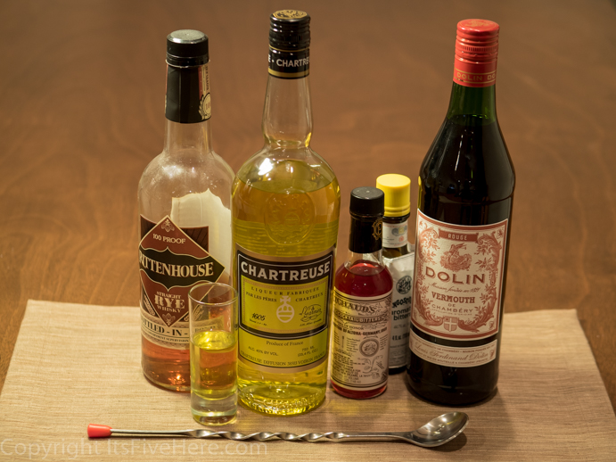 All the ingredients needed to make a Greenpoint cocktail (including Yellow Chartreuse)