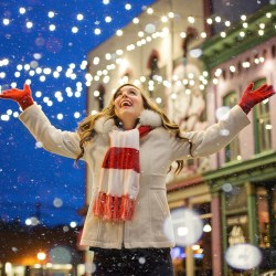 christmas-woman in snow holiday travel hacks