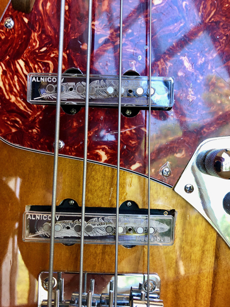 Alnico V Masterbuilt pickups with see-thru acrylic tops and feather etching. That's funky!