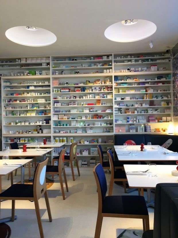 Walls lined with pill bottles at Pharmacy2