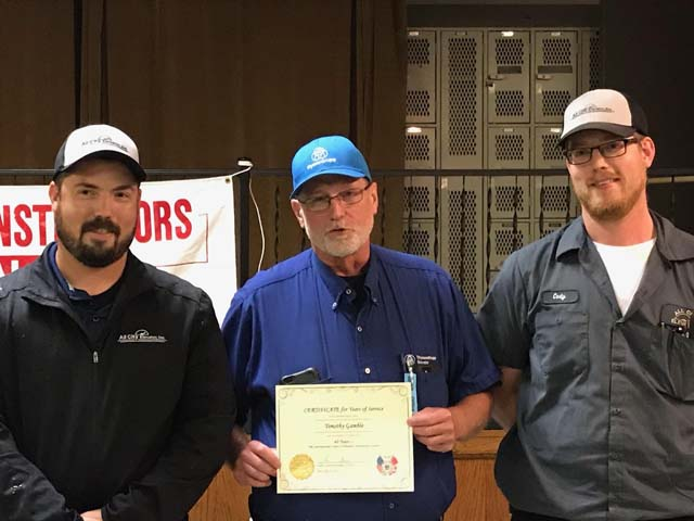 L9 Tim Gamble receiving his 40-year pin with his Elevator Constructor sons Matt and Cody