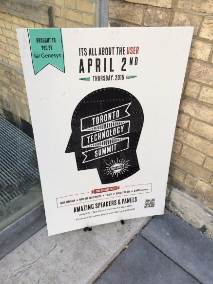 """It's about the user"" says the sign for Genesys' Toronto Technology Summit event on April 2, 2015"