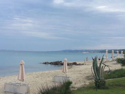Sunbeds and umbrellas - Pallini Beach Hotel Review