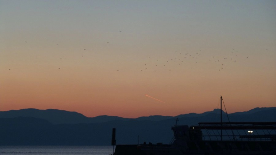 Red sky as the sunset goes down. Watching the sunset over Lake Ohrid. Beautiful sunset photos. Amazing sunset photos.