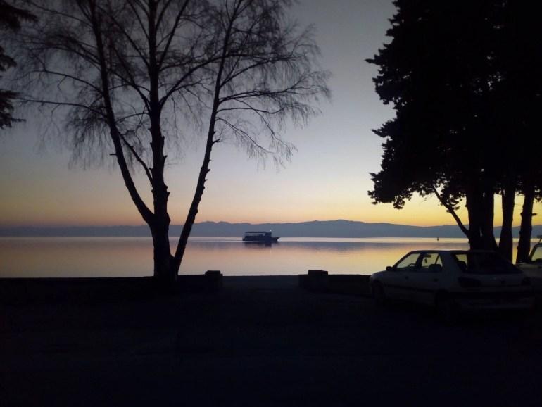 Boat ride during a sunset at Lake Ohrid. Watching the sunset over Lake Ohrid. Beautiful sunset photos. Amazing sunset photos.