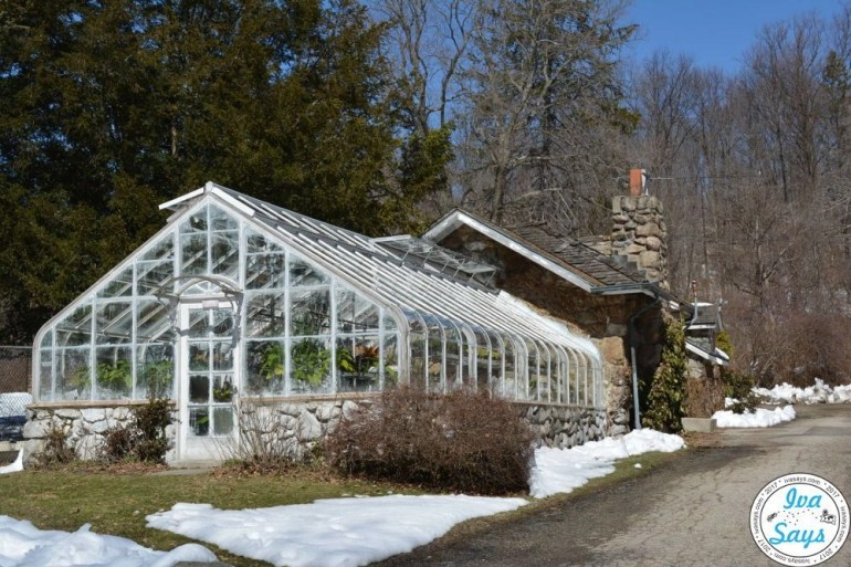 Greenhouse in the New Jersey Botanical Gardens at Skylands with snow around the ground.