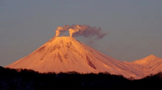 The Volcano Avachinsky Kamchatka with smoke coming out of it. The fire element of find your travel element.