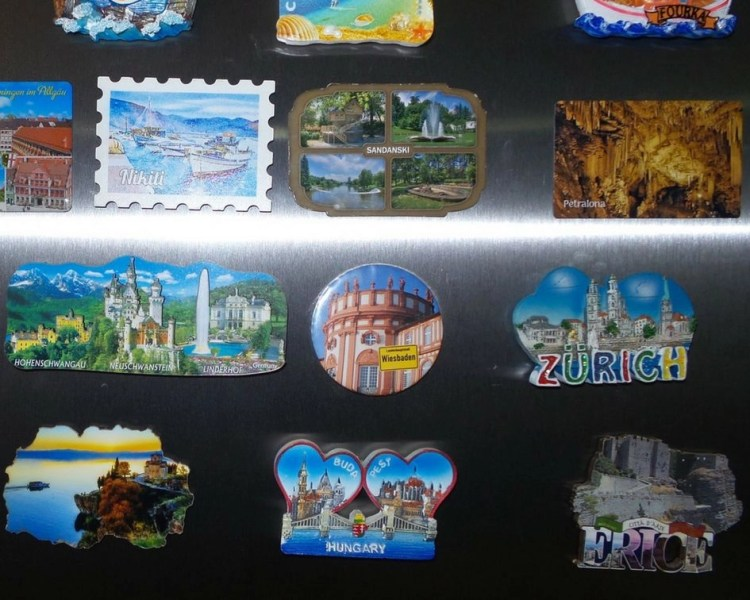 Collection of different fridge magnets of visited countries in Europe.