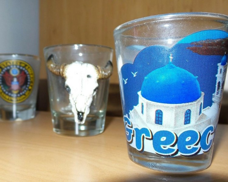Shot glass of Santorini, Greece, and a bull with horns for Texas.