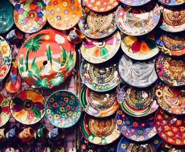 Collection of travel souvenirs at a shop.