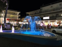A fountain that changes colors, now blue, located in the center of Chaniotis, Greece