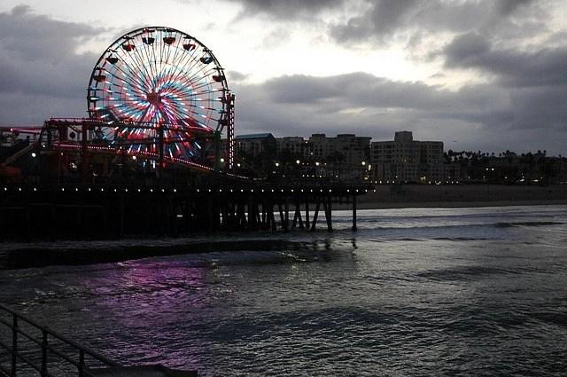 Ferris Wheel in the Santa Monica Pier during a cloudy day.