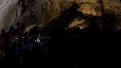 """The """"Big"""" Lake depicted in the distance in Vrelo with darkness around the cave."""