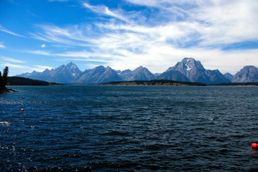 A large body of water with a mountain in the background.