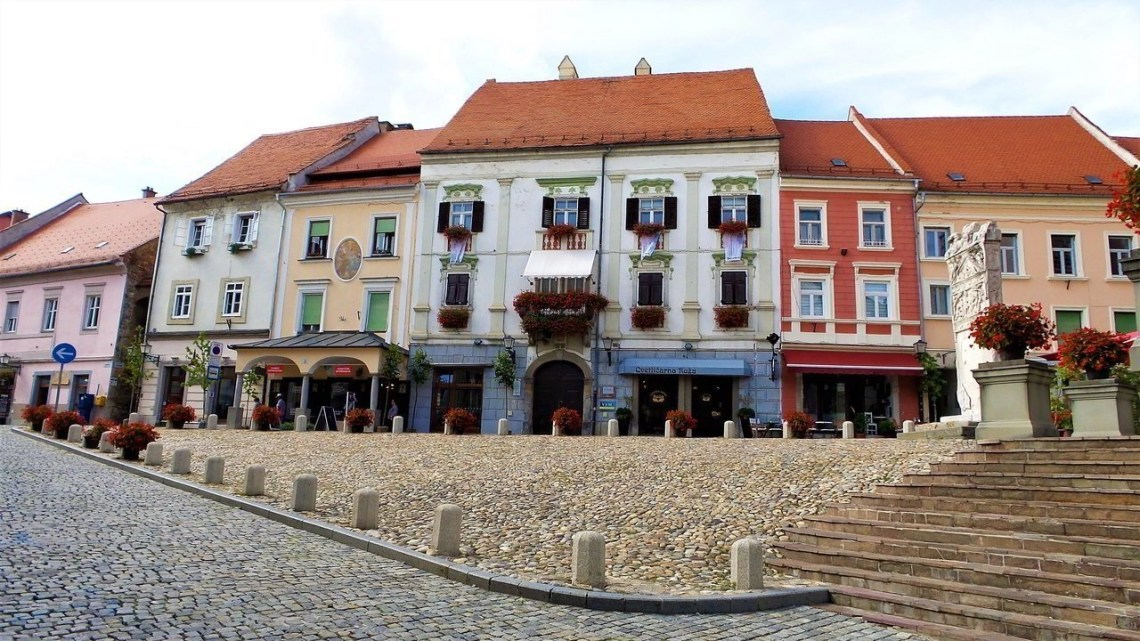 Houses in different colors on a street in the old town of Ptuj in Slovenia.
