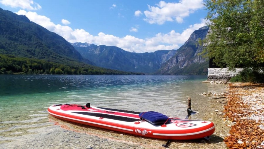 A red paddle board in Lake Bohinj in Triglav National Park in Slovenia.