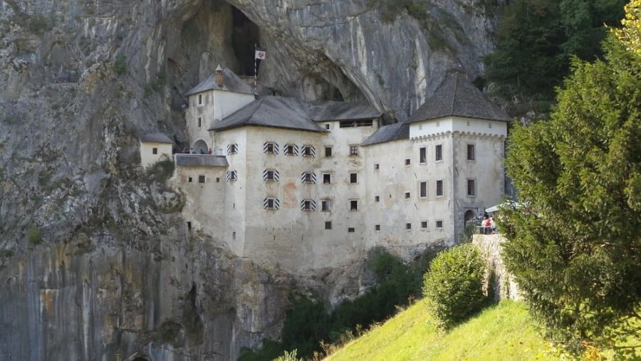 A castle in a mountain in Postojna, Slovenia - Predjamski Castle.