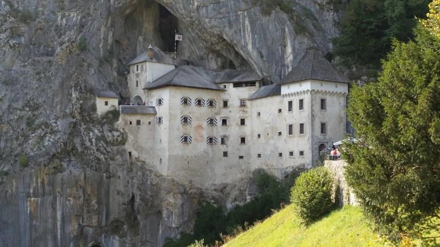 A castle in a mountain in Postojna, Slovenia - Predjamski Castle.