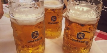 Three One-Liter Beer Mugs at Oktoberfest in Munich. Germany